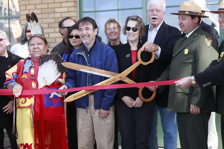 Big scissors and big honors were part of the opening of the visitors center at Rosie the Riveter/World War II Home Front National Historic Park. Photo: Jill Schneider, The Chronicle