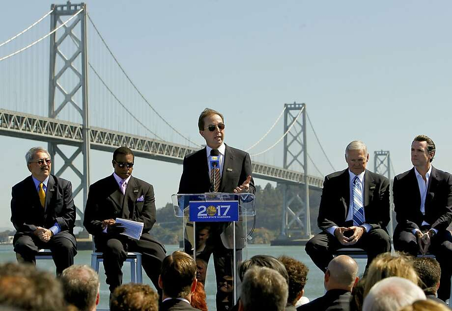 (l to r) San Francisco Mayor Ed Lee, sports personality Ahmad Rashad, Golden State Warriors owner, Joe Lacob, (speaking), former NBA player and Warriors executive, Jerry West and Lt. Governor Gavin Newson as they officially announced plans, on Tuesday May 22, 2012, in San Francisco,Ca., to build a new arena on Piers 30 and 32 in time for the start of the 2017-2018 NBA season. Photo: Michael Macor, The Chronicle