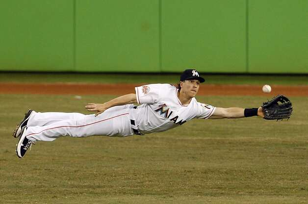 Miami Marlins center fielder Chris Coghlan stretches for a triple hit by San Francisco Giants' Ryan Theriot in the eighth inning of a baseball game in Miami, Saturday, May 26, 2012. The Marlins defeated the Giants 5-3. (AP Photo/Lynne Sladky) Photo: Lynne Sladky, Associated Press