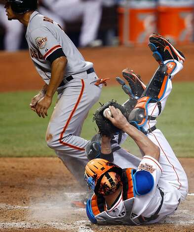 MIAMI, FL - MAY 26:  Emmanuel Burriss #2 of the San Francisco Giants slides safely into home before the tag of John Buck #14 of the Miami Marlins during a game at Marlins Park on May 26, 2012 in Miami, Florida.  (Photo by Sarah Glenn/Getty Images) Photo: Sarah Glenn, Getty Images