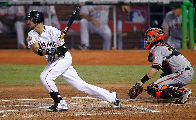 MIAMI, FL - MAY 26: Omar Infante #12 of the Miami Marlins hits a single during a game against the San Francisco Giants at Marlins Park on May 26, 2012 in Miami, Florida.  (Photo by Sarah Glenn/Getty Images) Photo: Sarah Glenn, Getty Images