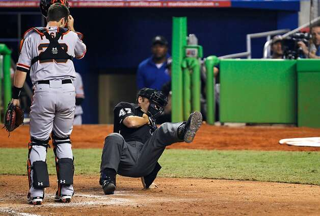 MIAMI, FL - MAY 26: Home plate umpire Mark Wegner #47 is hit by a pitch during a game between the Miami Marlins and the San Francisco Giants at Marlins Park on May 26, 2012 in Miami, Florida.  (Photo by Sarah Glenn/Getty Images) Photo: Sarah Glenn, Getty Images