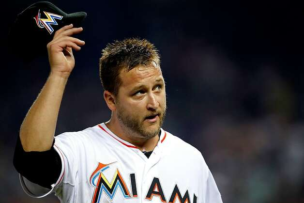 MIAMI, FL - MAY 26:  Mark Buehrle #56 of the Miami Marlins takes tips his hat to an applauding crowd during a game against the San Francisco Giants at Marlins Park on May 26, 2012 in Miami, Florida. The Marlins defeated the Giants 5-3. (Photo by Sarah Glenn/Getty Images) Photo: Sarah Glenn, Getty Images
