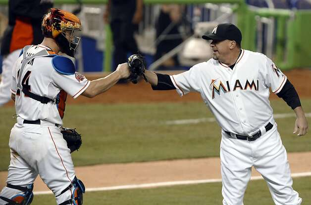 Miami Marlins relief pitcher Randy Choate, right, celebrates with catcher John Buck, left, after the Marlins defeated the San Francisco Giants 5-3 in a baseball game in Miami, Saturday, May 26, 2012. (AP Photo/Lynne Sladky) Photo: Lynne Sladky, Associated Press