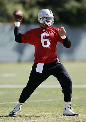 Oakland Raiders quarterback Terrelle Pryor throws during NFL football practice in Alameda, Calif., Tuesday, May 22, 2012. (AP Photo/Marcio Jose Sanchez) Photo: Marcio Jose Sanchez, Associated Press