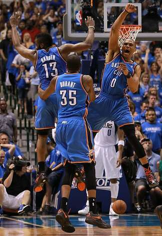 DALLAS, TX - MAY 05:  (L-R) James Harden #13, Kevin Durant #35 and Russell Westbrook #0 of the Oklahoma City Thunder celebrate after scoring with 10 seconds against the Dallas Mavericks during Game Four of the Western Conference Quarterfinals in the 2012 NBA Playoffs at American Airlines Center on May 5, 2012 in Dallas, Texas. NOTE TO USER: User expressly acknowledges and agrees that, by downloading and or using this photograph, User is consenting to the terms and conditions of the Getty Images License Agreement.  (Photo by Ronald Martinez/Getty Images) ***BESTPIX*** Photo: Ronald Martinez, Getty Images