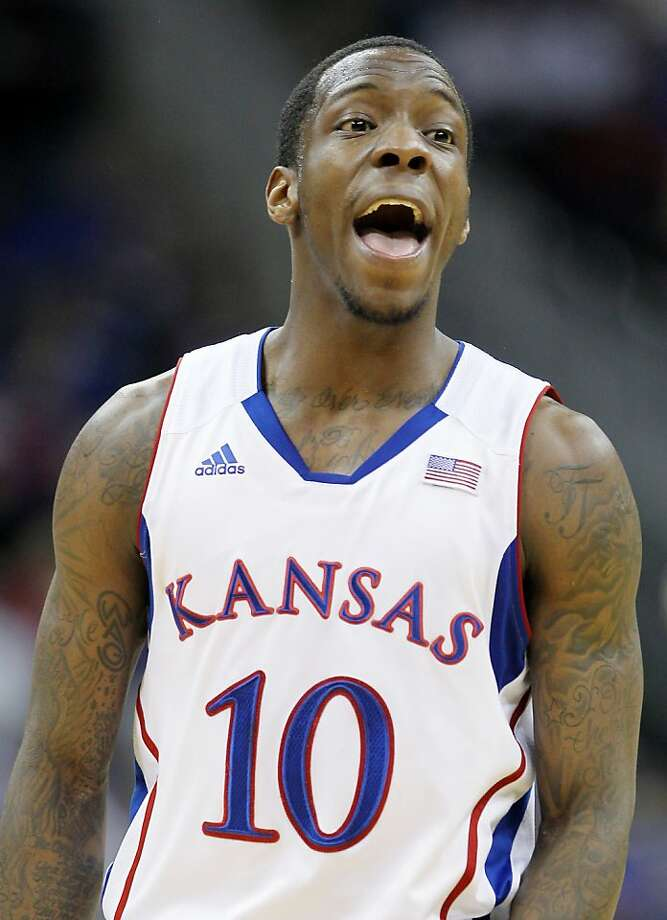 KANSAS CITY, MO - MARCH 09:  Tyshawn Taylor #10 of the Kansas Jayhawks reacts in the first half against the Baylor Bears during the semifinals of the 2012 Big 12 Men's Basketball Tournament at Sprint Center on March 9, 2012 in Kansas City, Missouri.  (Photo by Jamie Squire/Getty Images) Photo: Jamie Squire, Getty Images