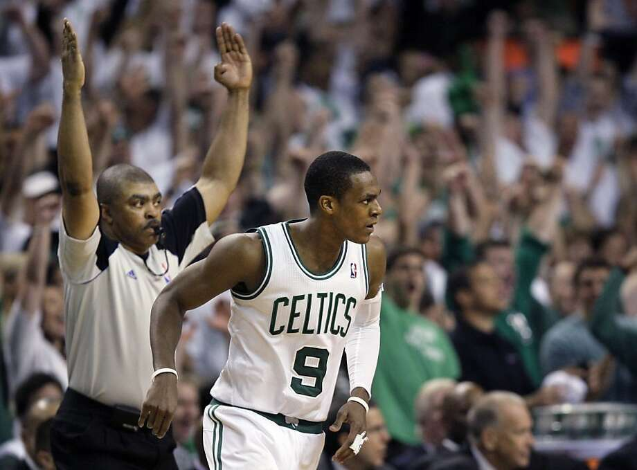 The referee signals a made 3-point basket for Boston Celtics guard Rajon Rondo during the fourth quarter of Game 7 against the Philadelphia 76ers in an NBA basketball Eastern Conference semifinal playoff series, Saturday, May 26, 2012, in Boston. The Celtics won 85-75 to advance to the conference finals against the Miami Heat. (AP Photo/Elise Amendola) Photo: Elise Amendola, Associated Press