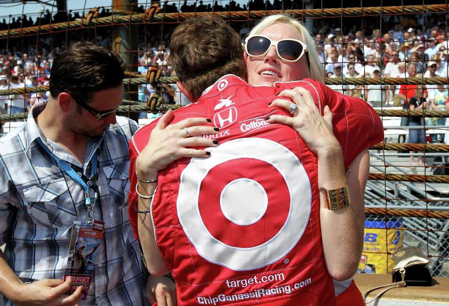 INDIANAPOLIS, IN - MAY 27:  Scott Dixon, driver of the #9 Target Chip Ganassi Racing Honda hugs Susie Wheldon, the wife of the late Dan Wheldon, prior to the start of the IZOD IndyCar Series 96th running of the Indianpolis 500 mile race at the Indianapolis Motor Speedway on May 27, 2012 in Indianapolis, Indiana. Dan Wheldon died in a massive car wreck on October 16, 2011 during the Las Vegas Indy 300 at Las Vegas Motor Speedway. Photo: Nick Laham, Getty Images / 2012 Getty Images