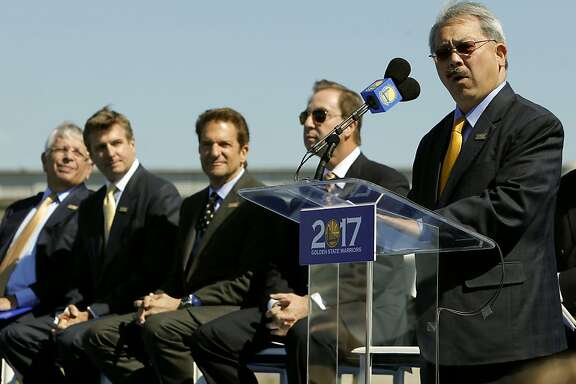 (l to r) NBA commissioner, David Stern, and Golden State Warriors basketball team executives, Rick Welts, Peter Guber, Joe Lacob, listen to San Francisco Mayor Ed Lee, as plans were officially annonunced, on Tuesday May 22, 2012, in San Francisco,Ca., to build a new arena on Piers 30 and 32 in time for the start of the 2017-2018 NBA season.
