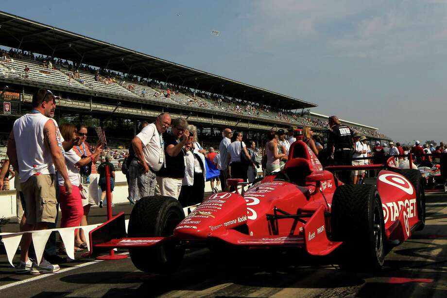 INDIANAPOLIS, IN - MAY 27:  A fan admire the #50 Target Chip Ganassi Racing Honda driven by Dario Franchitti (not pictured) on pit road prior to the IZOD IndyCar Series 96th running of the Indianpolis 500 mile race at the Indianapolis Motor Speedway on May 27, 2012 in Indianapolis, Indiana. Photo: Chris Trotman, Getty Images / 2012 Getty Images