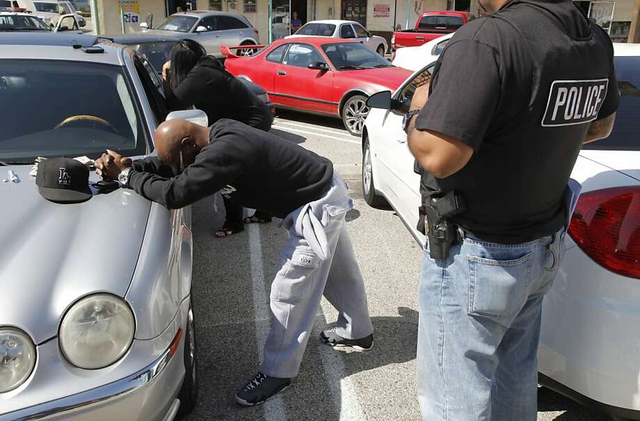 In this photo taken April 10, 2012, a suspect is arrested after a raid by the Los Angeles County Sheriff's Department's Major Crimes Health Authority Law Enforcement Task Force, HALT unit, with local, state and federal investigators. Authorities raided a fake health clinic, operating as a pill mill by illegally dispensing medical prescriptions for OxyContin and other drugs in Sylmar, Calif. (AP Photo/Damian Dovarganes) Photo: Damian Dovarganes, Associated Press