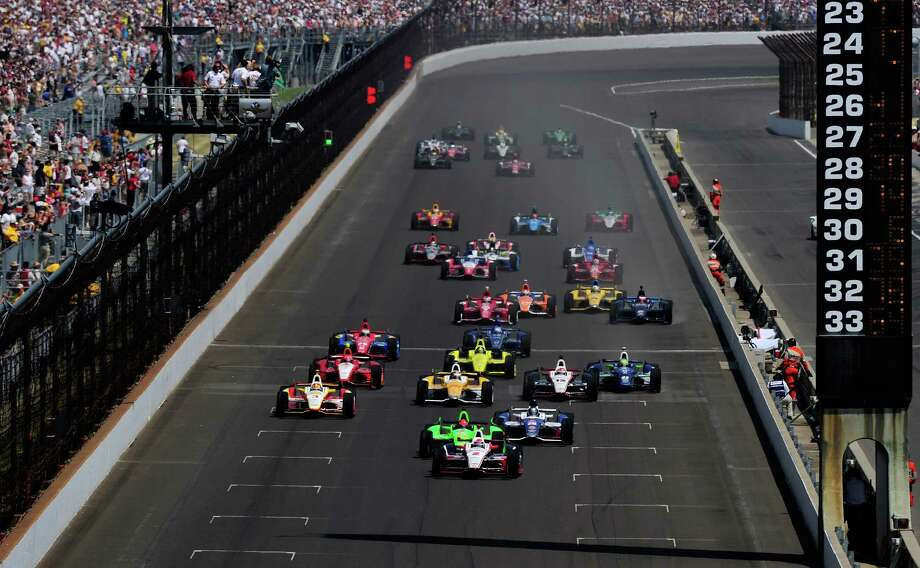 INDIANAPOLIS, IN - MAY 27:  Ryan Brisco, driver of the #2 IZOD Team Penske Chevrolet, leads the field at the start of the IZOD IndyCar Series 96th running of the Indianpolis 500 mile race at the Indianapolis Motor Speedway on May 27, 2012 in Indianapolis, Indiana. Photo: Robert Laberge, Getty Images / 2012 Getty Images