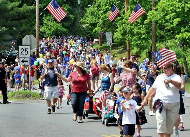 The Brookfield Memorial Day Parade approaches Williams Park where the Memorial Ceremony had just concluded Sunday, May 27, 2012. Photo: Michael Duffy