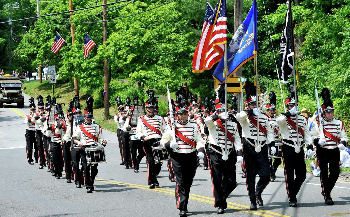 The Danbury Drum Corps leads the Brookfield Memorial Day Parade Sunday, May 27, 2012.
