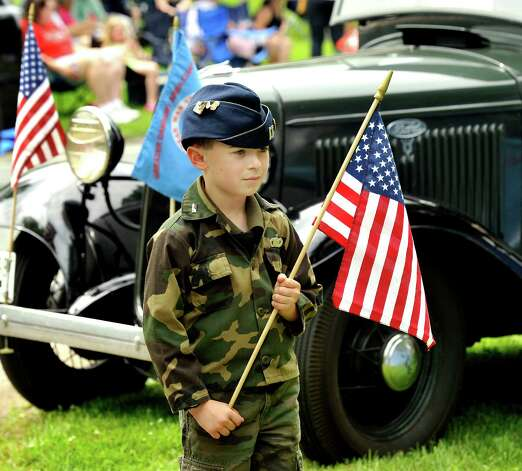 Steven Johnston, 8, of New Fairfield, takes part in the Memorial Ceremony as part of the Brookfield Memorial Day Parade Sunday, May 27, 2012. Photo: Michael Duffy / The News-Times