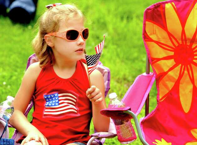 Julia Scholten, 8, watches the Brookfield Memorial Day Parade Sunday, May 27, 2012. Photo: Michael Duffy / The News-Times