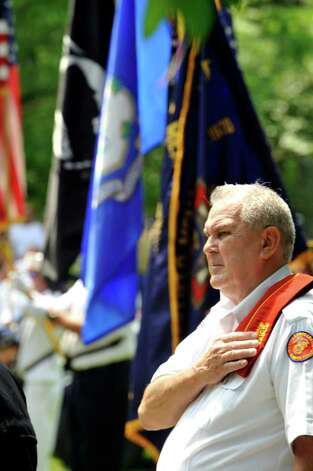 Frank Johnson, commander of VFW Post 10201, observes a memorial ceremony at Williams Park as part of the Brookfield Memorial Day Parade Sunday, May 27, 2012. Photo: Michael Duffy / The News-Times