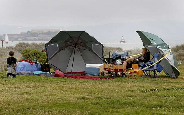Matt Feabey of Rohnert Park set up his fireworks viewing area early on Crissy Field. The Golden Gate Bridge celebrated its 75th anniversary with tours, displays, and music, ending with a fireworks display in San Francisco, Calif. Sunday May 27, 2012. Photo: Brant Ward, The Chronicle