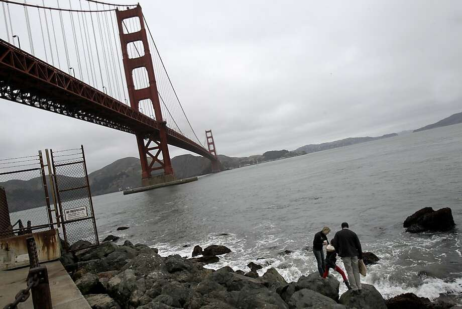 A family braved the rocks and surf to get a closer look at some tidal creatures near Fort Point. The Golden Gate Bridge celebrated its 75th anniversary with tours, displays, and music, ending with a fireworks display in San Francisco, Calif. Sunday May 27, 2012. Photo: Brant Ward, The Chronicle