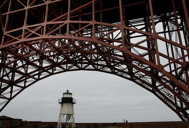 A couple stops to photograph the Golden Gate Bridge while visiting Fort Point.  The huge arch and the light house are overhead. The Golden Gate Bridge celebrated its 75th anniversary with tours, displays, and music, ending with a fireworks display in San Francisco, Calif. Sunday May 27, 2012. Photo: Brant Ward, The Chronicle