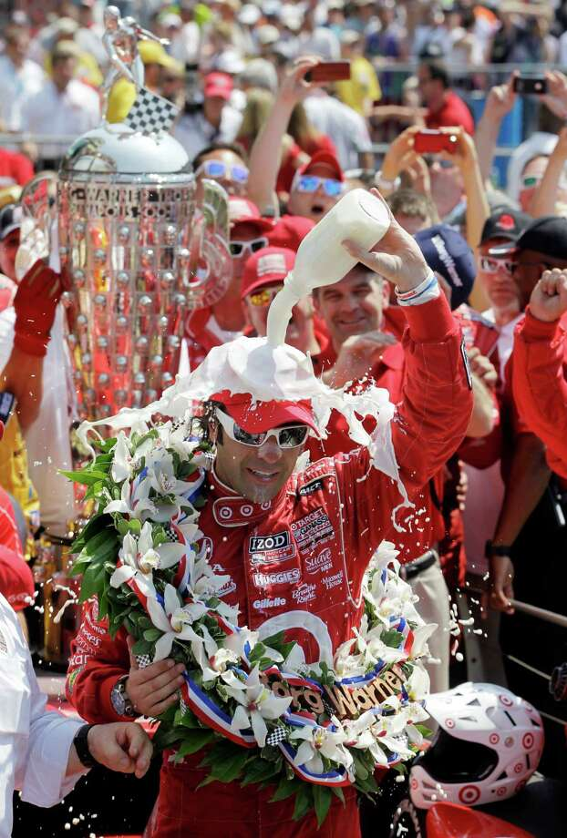 Dario Franchitti, of Scotland, celebrates in victory circle after winning IndyCar's Indianapolis 500 auto race at Indianapolis Motor Speedway in Indianapolis, Sunday, May 27, 2012. (AP Photo/Darron Cummings) Photo: Darron Cummings, Associated Press / AP