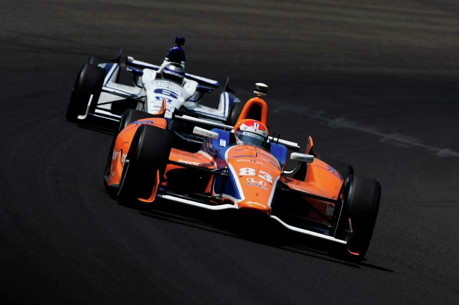 INDIANAPOLIS, IN - MAY 27:  Charlie Kimball, driver of the #83 NovoLog FlexPen Honda, leads Katherine Legge of England, driver of the #6 TrueCar-Dragon Racing Chevrolet, during the IZOD IndyCar Series 96th running of the Indianpolis 500 mile race at the Indianapolis Motor Speedway on May 27, 2012 in Indianapolis, Indiana. Photo: Robert Laberge, Getty Images / 2012 Getty Images