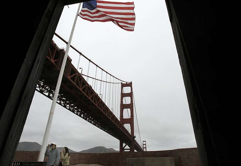 Noriaki (left) and Hiroko Fukui of San Jose, Calif. took pictures from Fort Point. The Golden Gate Bridge celebrated its 75th anniversary with tours, displays, and music, ending with a fireworks display in San Francisco, Calif. Sunday May 27, 2012. Photo: Brant Ward, The Chronicle