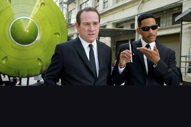 "Tommy Lee Jones (left) and Will Smith star in a scene from ""Men in Black 3."" Photo: Sony Pictures"