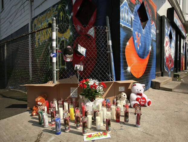 A memorial to the slain Francisco J. Barbosa, 23 of Bridgeport, outside the New Era Sports Cafe at the intersection of Pembroke and Arctic Streets in Bridgeport on Sunday, May 27, 2012. The homicide is the tenth in the city this year. Photo: Brian A. Pounds / Connecticut Post