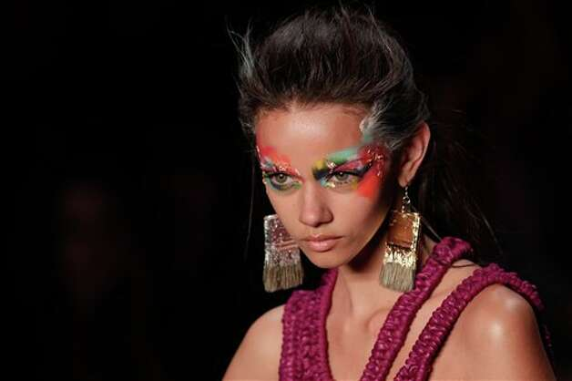 A model wears a creation from the Triya summer collection during Fashion Rio in Rio de Janeiro, Brazil, Saturday May  26, 2012. (AP Photo/Felipe Dana) Photo: Associated Press