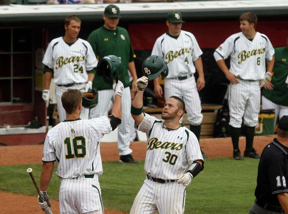 Big 12 player of the year Josh Ludy (30) and the Baylor Bears will be among 16 hosts for the NCAA baseball regionals that begin Friday. Texas A&M and Rice are the other hosts from Texas. Photo: Sue Ogrocki, Associated Press