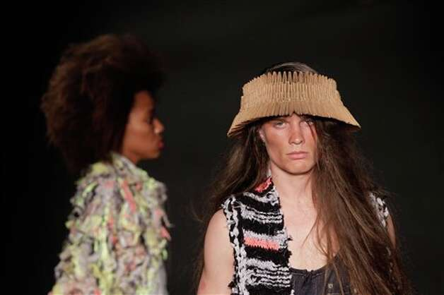 A model wears a creation from the Oestudio summer collection at Fashion Rio in Rio de Janeiro, Brazil, Saturday, May 26, 2012. (AP Photo/Felipe Dana) Photo: Associated Press