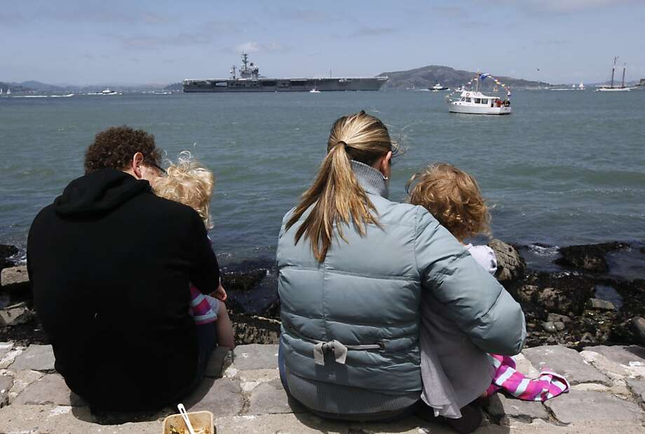 Josh Morenstein and Melissa Little watch the arrival of the aircraft carrier Nimitz at the Marina Green with their 3-year-old twins Tessa and Chloe during the 75th anniversary celebration for the Golden Gate Bridge in San Francisco, Calif. on Sunday, May 27, 2012. Photo: Paul Chinn, The Chronicle