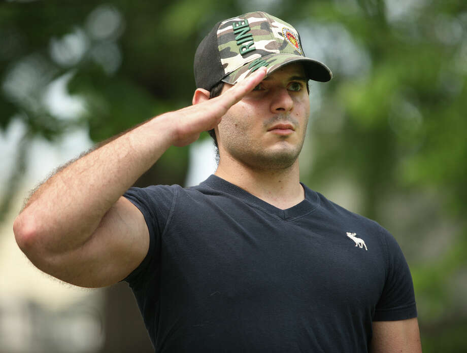 US Marine Lance Cpl. Joshua Flashman of Stratford, salutes as taps is played during the Memorial Day ceremony on the Green in Milford on Sunday, May 27, 2012. Photo: Brian A. Pounds / Connecticut Post