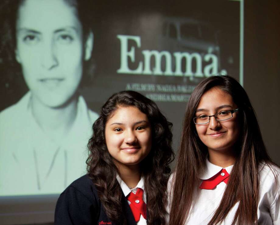 Young Women's Leadership Academy students Andrea Martinez (left) and Nadia Balderas pose in front of an introduction screen to their documentary about 1930s local labor organizer Emma Tenayuca. Photo: William Luther, San Antonio Express-News / © 2012 WILLIAM LUTHER