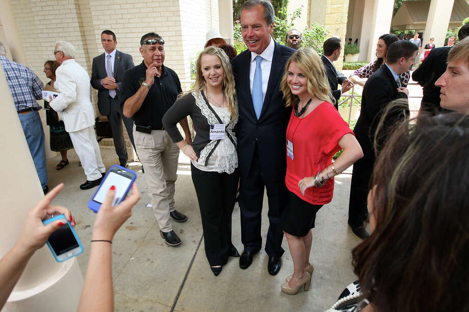 Lt. Gov. David Dewhurst (center), running for the Republican nomination of the U.S. Senate, poses with Cornerstone Church hostesses Amanda Smith (left) and Melissa Trott after Sunday's service, May 27, 2012. Photo: Jerry Lara, San Antonio Express-News / © 2012 San Antonio Express-News