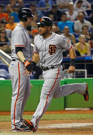 MIAMI, FL - MAY 27: Melky Cabrera #53 is congratulated by Aubrey Huff #17 of the San Francisco Giants during a game against the Miami Marlins at Marlins Park on May 27, 2012 in Miami, Florida.  (Photo by Mike Ehrmann/Getty Images) Photo: Mike Ehrmann, Getty Images