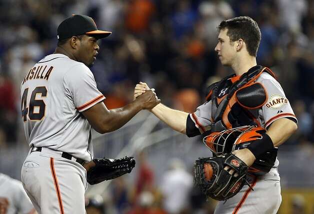 San Francisco Giants relief pitcher Santiago Casilla (46) shakes hands with catcher Buster Posey, right, after defeating the Miami Marlins 3-2 during a baseball game in Miami, Sunday, May 27, 2012. (AP Photo/Lynne Sladky) Photo: Lynne Sladky, Associated Press