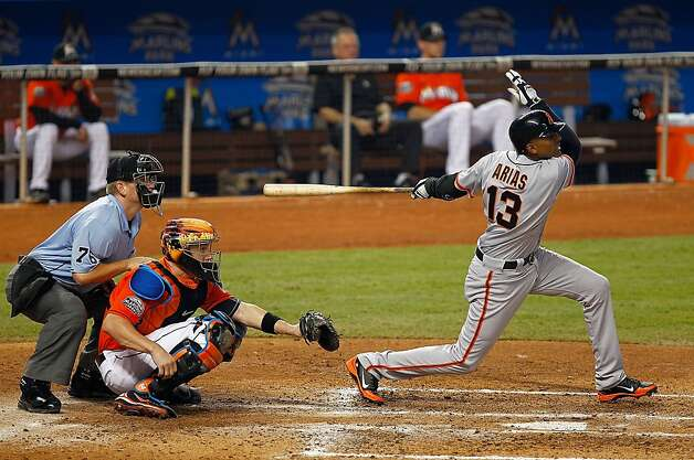 MIAMI, FL - MAY 27: Joaquin Arias #13 of the San Francisco Giants hits an RBI single during a game against the Miami Marlins at Marlins Park on May 27, 2012 in Miami, Florida.  (Photo by Mike Ehrmann/Getty Images) Photo: Mike Ehrmann, Getty Images
