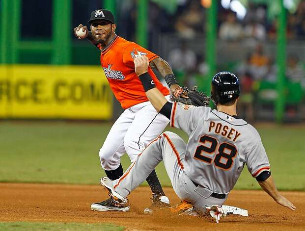 MIAMI, FL - MAY 27: Jose Reyes #7 of the Miami Marlins turns a double play as Buster Posey #28 of the San Francisco Giants slides into second during a game  at Marlins Park on May 27, 2012 in Miami, Florida.  (Photo by Mike Ehrmann/Getty Images) Photo: Mike Ehrmann, Getty Images