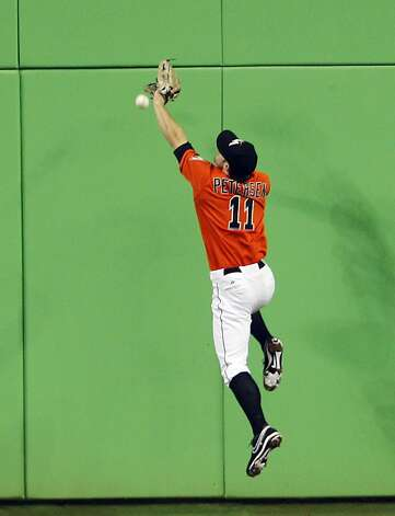 Miami Marlins' Bryan Petersen cannot make the catch on a double hit by San Francisco Giants' Buster Posey to score Melky Cabrera in the sixth inning during a baseball game in Miami, Sunday, May 27, 2012. (AP Photo/Lynne Sladky) Photo: Lynne Sladky, Associated Press