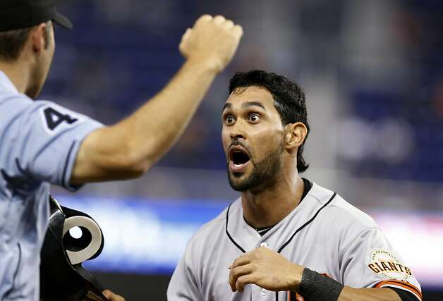 San Francisco Giants' Angel Pagan, right, reacts after being called out at third by umpire Mark Wegner, left, while trying to steal home in the ninth inning during a baseball game against the Miami Marlins in Miami, Sunday, May 27, 2012. The Giants won 3-2. (AP Photo/Lynne Sladky) Photo: Lynne Sladky, Associated Press