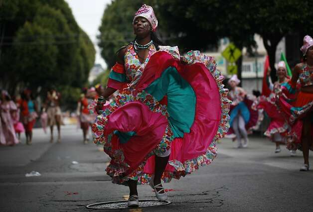 Natalie Peacock with Rara Tou Limen make her way down 24th Street during the 34th annual Carnaval parade on Sunday May 27, 2012 in San Francisco, Calif. Photo: Mike Kepka, The Chronicle