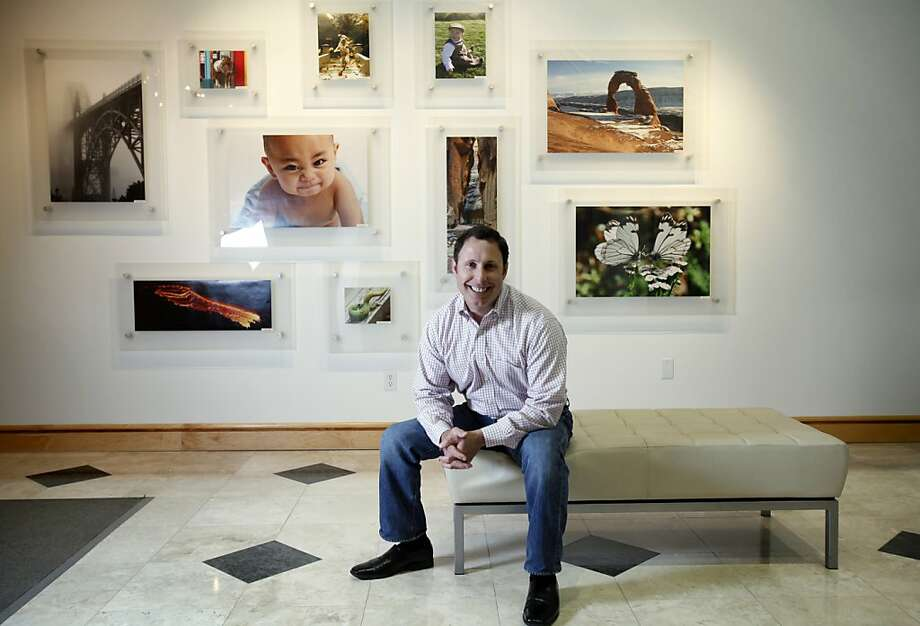 "Shutterfly CEO Jeff Housenbold says, ""Our model is to become the next Apple, not the latest one-hit wonder with no revenue model."" The firm plans to be the dominant source online for saving, sharing and publishing digital photos, cards and gifts. Photo: Sarah Rice, Special To The Chronicle"