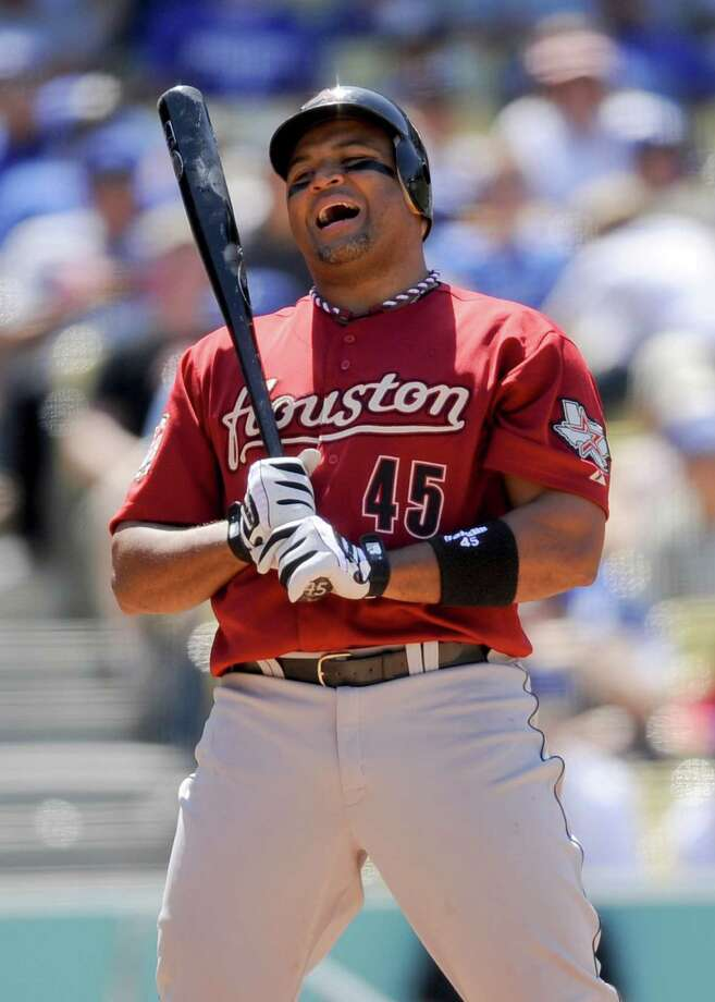 Houston Astros' Carlos Lee reacts to a strike call in the sixth inning of a baseball game against the Los Angeles Dodgers, Sunday, May 27, 2012, in Los Angeles. Photo: AP