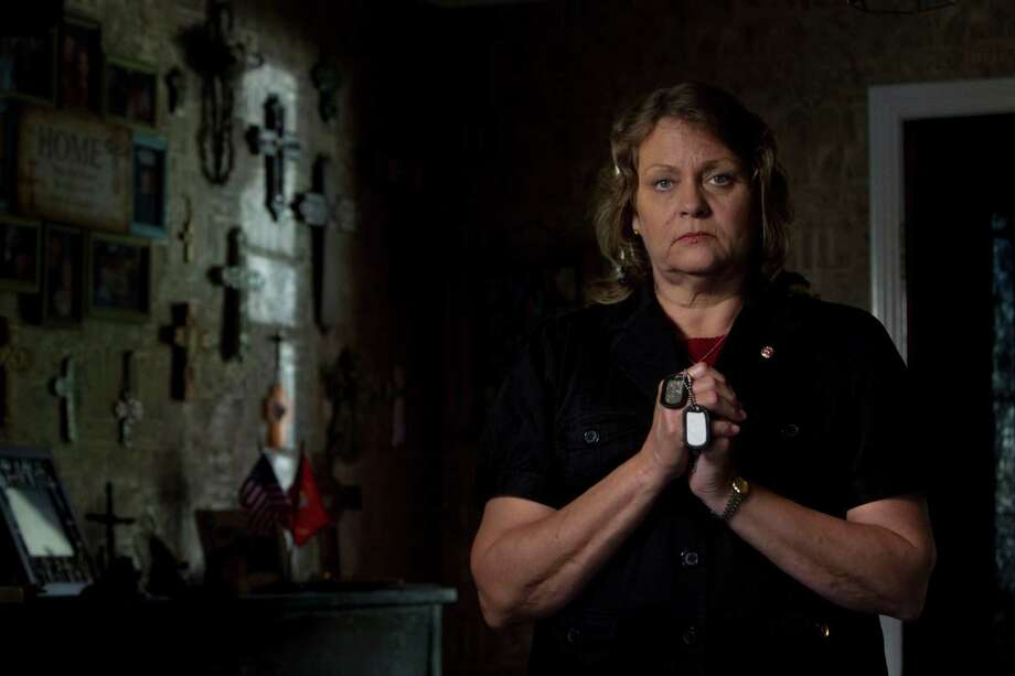 Jeannine Maughmer Miller, of Pearland, is mother of Marine Lance Cpl. Ryan Adam Miller, 19, killed in Iraq by a bomb in 2006. Photo: Johnny Hanson / © 2012  Houston Chronicle