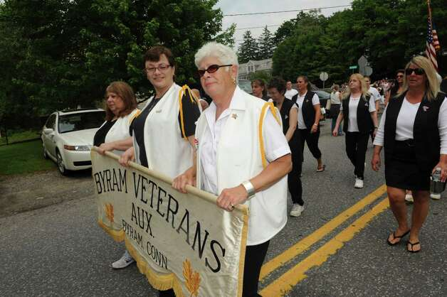 Gina Lagano, Maria Severo, and Betty Shopovick hold the Byram Veterans Aux banner during the Byram Veterans Association's Memorial Day Parade Sunday, May 27, 2012. Photo: Helen Neafsey / Greenwich Time