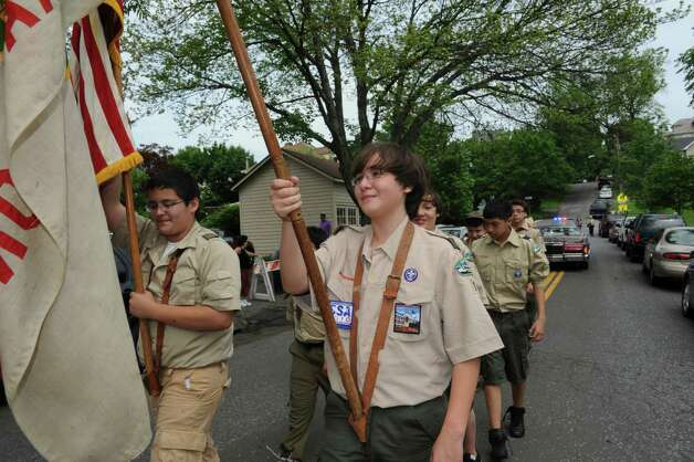 Boy Scout Brandon Defreitas, 13, left, holds the American flag and Felipe Ibanez, 14, holds the Boy Scout flag during the Byram Veterans Association's Memorial Day Parade Sunday, May 27, 2012. Photo: Helen Neafsey / Greenwich Time