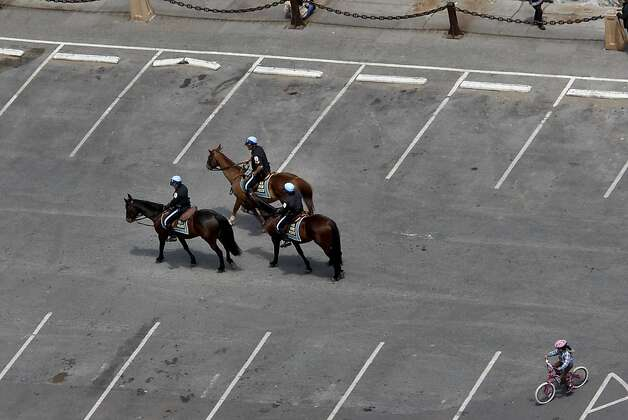 A group of mounted police officers went through a vacant parking lot at Fort Point. The Golden Gate Bridge celebrated its 75th anniversary with tours, displays, and music, ending with a fireworks display in San Francisco, Calif. Sunday May 27, 2012. Photo: Brant Ward, The Chronicle
